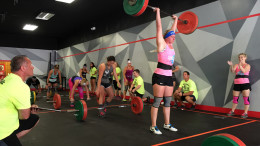 Female competitors performing WOD 1 Cluster ladder during Downtown Throwdown II.