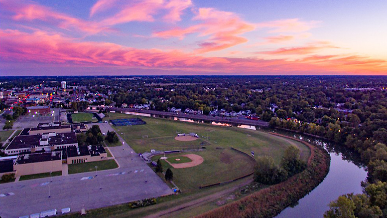 Aerial image overlooking the downtown area, Muncie Central High School, and White River. Photo by: Michael Wolfe