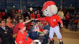 Fist bump at the Reds Caravan held at Stoops Buick GMC. Photo by: Mike Rhodes