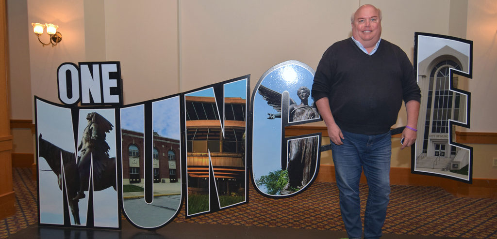 "Charles Jamieson is photographed by the ""One Muncie"" sign at the Mayor's State of the City Address. Photo by: Mike Rhodes"