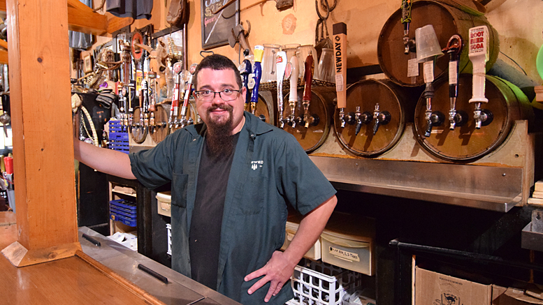 Bartender Mike Favors of the Heorot Pub and Draught House in downtown Muncie is pictured. Photo by: Mike Rhodes