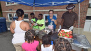 "A scene from the Harvest Soup Kitchen's ""Summer Fun Fest"" held last year. File photo."
