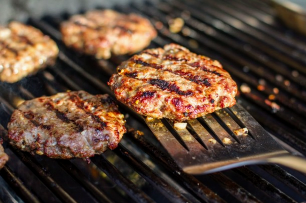 Burgers are easy to start with when using your outdoor grill.