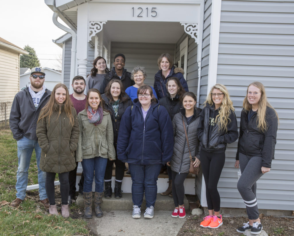 Ball State Journalism Instructor Kate Elliott is guiding a team of marketing, public relations, and advertising students to help ecoREHAB tell its compelling story. The students met with ecoREHAB's latest homeowner, Norma Ruttan, at her home on 10th Street. Photo provided.