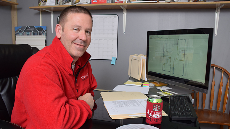 Jay Demaree is pictured in his office reviewing some recent project drawings. Photo by: Mike Rhodes