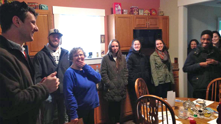ecoREHAB Executive Director Craig Graybeal introduces Ball State students to Muncie native, Norma Ruttan, who purchased the nonprofit's latest rehabilitated home. The students—a mix of public relations, marketing, and advertising majors—are helping ecoREHAB increase the impact of its neighborhood revitalization efforts. Photo provided.