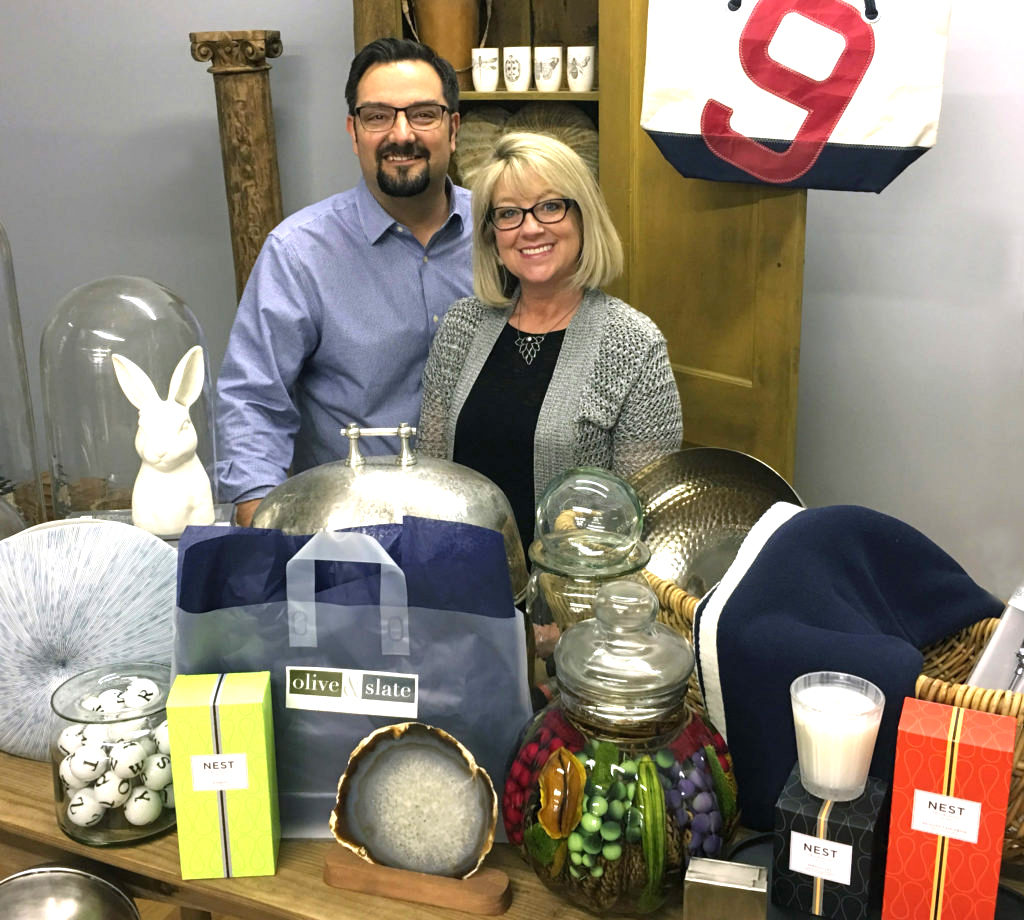 Sean and Heidi Hale are pictured behind some of the elegant and unique products they will be offering at Olive & Slate.
