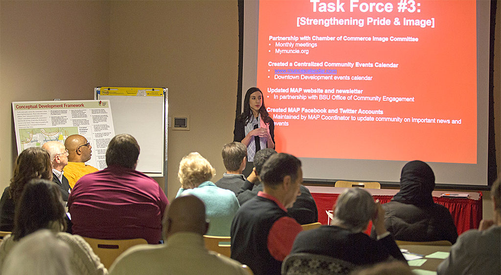 Muncie Action Plan Coordinator, Aimee Fant, introduces the MAP task forces to session participants. Photo provided.