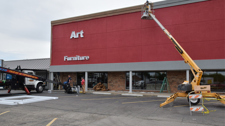 Signage Installers And Painters Working At The New Art Van Furniture Location In Muncie