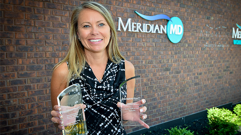 Pictured holding the awards—Jennifer Henderson, Director of Primary Care. Photo by: Mike Rhodes