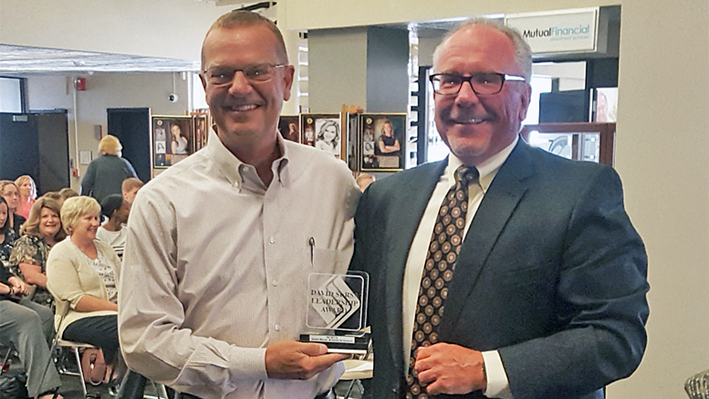 Pictured (L-R): Pat Botts is presented the 2017 David Sursa Leadership Award by Jeffrey R. Lang, Chairman of the Board of The Community Foundation. Photo provided.