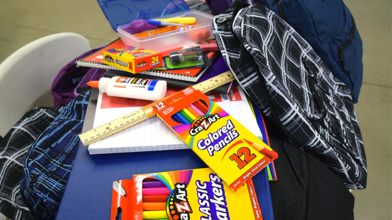 Some of the school supplies parents and children will find stuffed inside their free backpacks. Photo by: Mike Rhodes