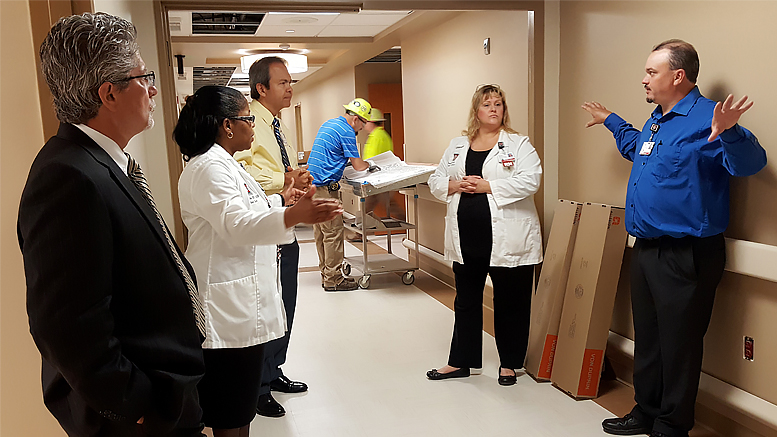 As the 9N Adult Surgical Unit remodel comes to a close, leaders take a tour and learn about the space and upgrades. From left to right: IU Health East Central Region President Dr. Jeff Bird, Administrative Director of Medical/Surgical Services Chanel Venable, IU Health Executive Vice President and Chief Operating Officer Al Gatmaitan, construction engineers in the background, Clinical Operations Manager Teresa Elliott, and Projects and Plant Operations Manager John Ward.