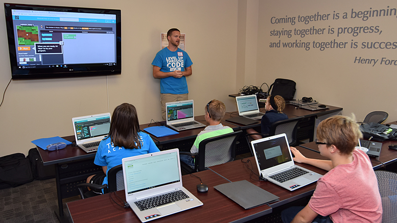 "Ryan Hunter presents to students at the the Coding Connector's ""Day of Code Foundations 1 & 2"" held on Saturday, August 26th. Photo by: Mike Rhodes"