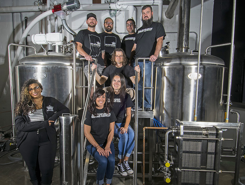 Pictured standing on the 15 barrel brew house—Men: (Top Row L-R)—Bill Kerr, Kyle Johnson, Sean Fickle, Jarrod Case, Jason Phillips. Women: (L-R) Felix Buck, Talia Schroeder, Jennifer Chrich. Photo by: Mike Rhodes