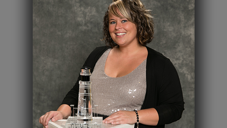 Erin Sellers, General Manager of the Red Lobster in Muncie, is pictured with her Lighthouse Club Award. Photo provided.