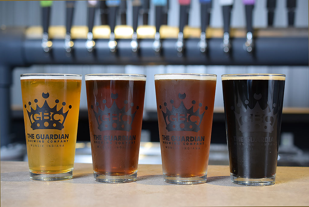 (From L-R) Four of Guardian Brewing Company's most popular beers: Chirptown Session Pale Ale, The Rez, Beauty School Dropout Amber, and Frank The Tank Coffee Stout. Photo by: Mike Rhodes