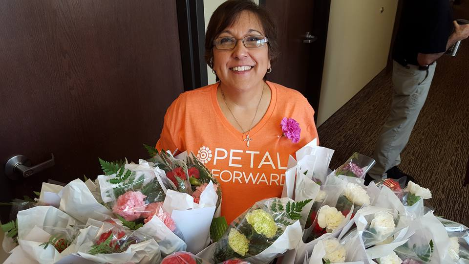 Sharon Grubbs is pictured with bouquets of happiness.