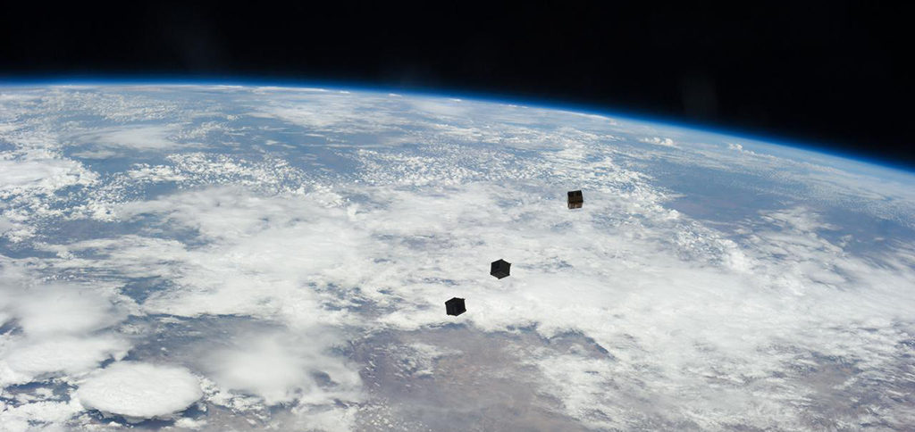 A view of three cube satellites after deployment. Photo courtesy of NASA.