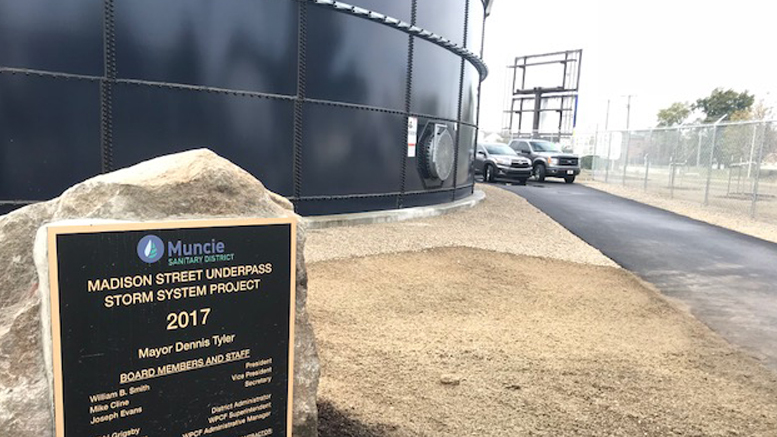 Madison Street Underpass Storm Sewer System plaque and 750,000-gallon steel storage tank. Photo by: Bowen Engineering.