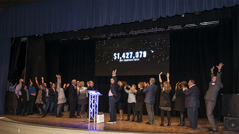 Results of the 2017 United Way Campaign are unveiled as members of the campaign team take the stage at Cornerstone. Photo by: Mike Rhodes