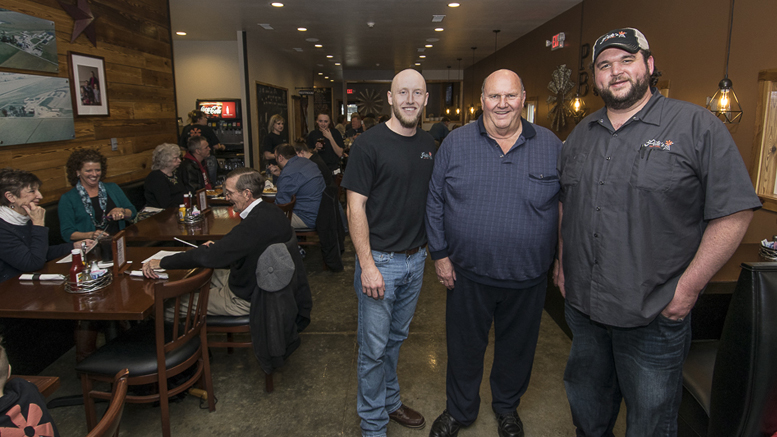 (L-R) Josh Shaffer, Phil Peterson and Caleb Churchill are pictured during the soft opening on March 29th. Photo by: Mike Rhodes