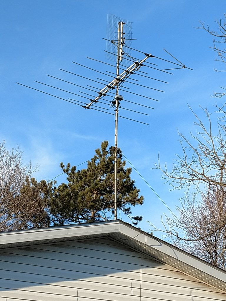 (tv antenna mounted on a garage rooftop )