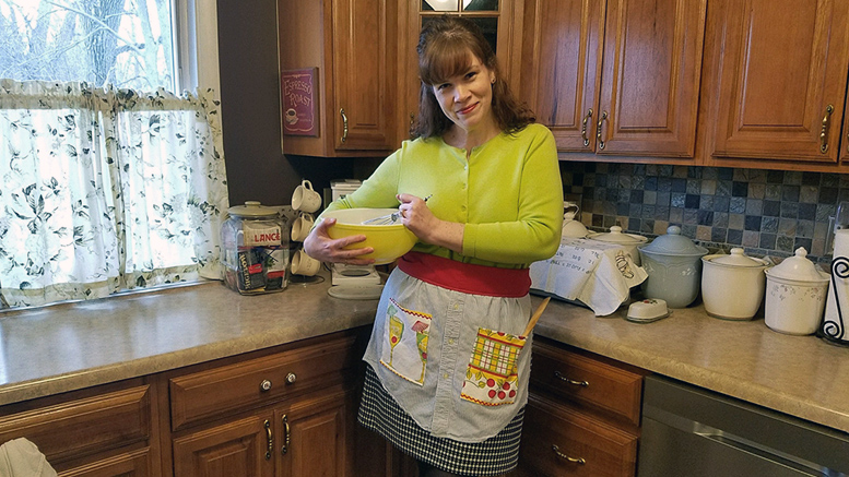 Heather Crouse models the apron she made using a recycled man's shirt.