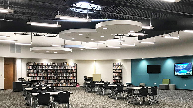"The Southern Wells Library Remodel included a new acoustical ceiling tile ""cloud"" feature. Work also included new casework, flooring, lighting, painting, dry-erase display surfaces, glass entry, media wall and furnishings."