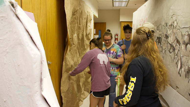 Academy students transform a classroom into a prehistoric cave for May Term. Photo provided.
