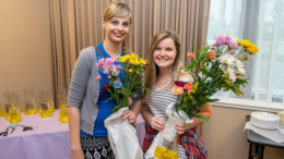(L-R) Lindsay Huffman and Liz Valpatic are pictured with the flowers they collected during Flower Hour. Photo by: Mike Rhodes