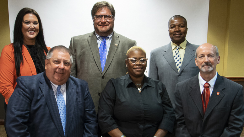 New MCS Board Members. Back row,(L-R) Brittany Bales, James Williams, Keith O'Neal. Front row, (L-R) Dave Heeter, WaTasha Barnes Griffin, James Lowe. Not pictured: Mark Ervin. Photo by: Mike Rhodes