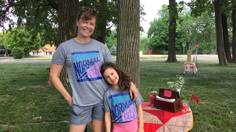 Normal City residents Jen Erickson and her daughter Anika wearing their neighborhood t-shirts while setting up for the June 2nd RNC summer picnic. Photo provided.