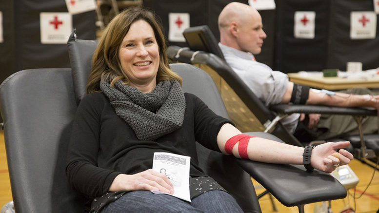 Heidi Reed sits in a donor chair following her blood donation. The day of Heidi's donation, her mother received blood during a surgery. Photo by Amanda Romney/American Red Cross