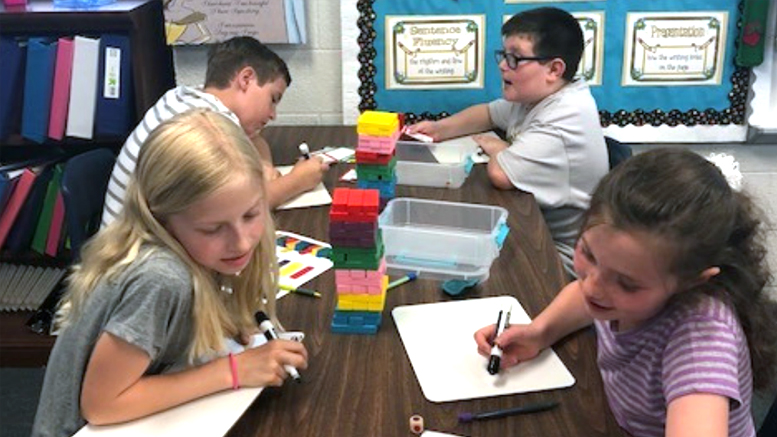 Fourth grade students reinforce math and science skills through a building block game as part of a 2017-2018 Robert P. Bell Education Grant. Photo provided.