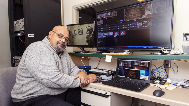 City of Muncie media director, Roger Overbey is pictured in the AV room operating the new equipment. Photo by: Mike Rhodes
