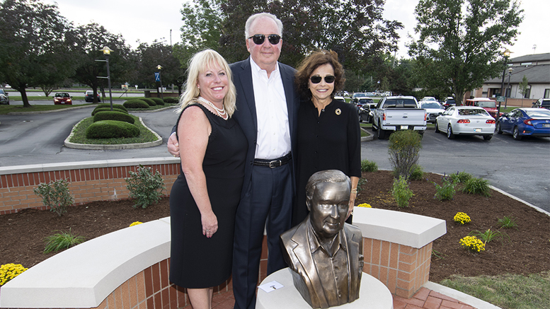 Kelly Stanley is pictured behind the sculpture created by Yorktown artist Kenneth Ryden. Also pictured is Donna Stanley (R) and Polly Craig (L) Executive Director, YOC foundation. Photo by: Mike Rhodes