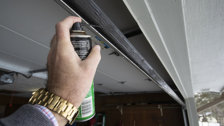 Spraying a silicone-based lubricant on the rubber base of your garage door will keep it from sticking/freezing to the pavement in very cold weather. Photo by: Mike Rhodes