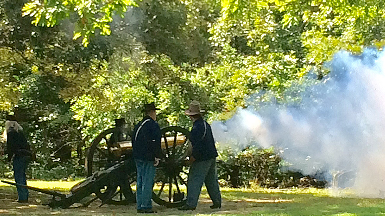 Smoke enshrouds the scene during a cannon demonstration. Photo by: Nancy Carlson