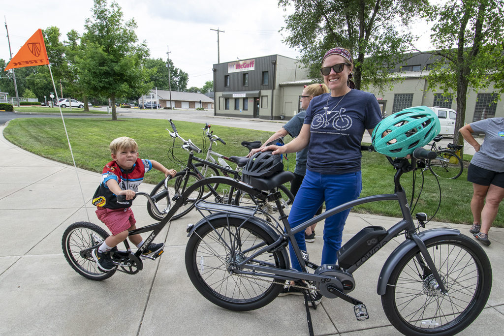 This little boy's bike is attached to his mom's through a tandem system as they pose for a photo prior to the community group ride. Photo by: Mike Rhodes