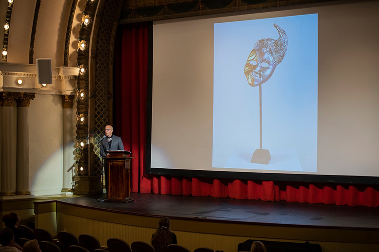 Jonathan Becker is pictured introducing his design for the 2019 Mayor's Arts Awards. Photo by: Mike Rhodes