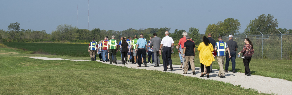 Attendees at the ribbon-cutting were given the opportunity to walk one lap of the track after the formal remarks. Photo by: Mike Rhodes