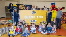 Members of the Pacers organization, community leaders, children and Santa are pictured during the toy giveaway at the Mitchell Early Childhood and Family Center. Photo by: Mike Rhodes