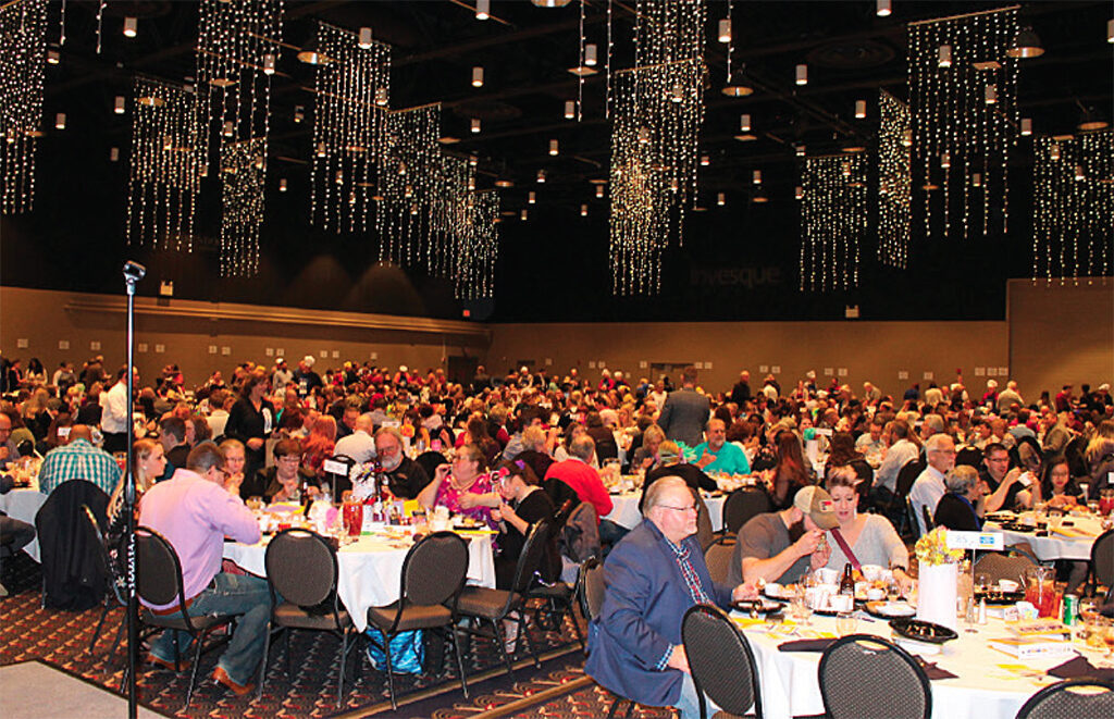 Supporters of the 100 Men Who Cook even dine at the Horizon Convention Center.