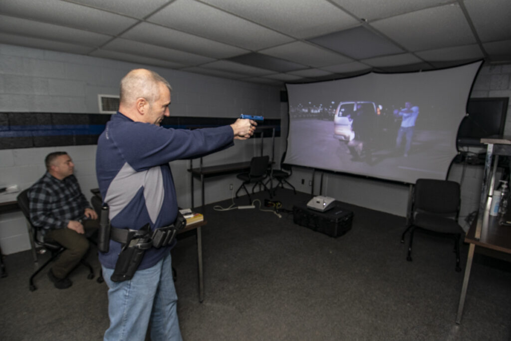 L-R: Lieutenant Andrew Payne leads a training session as Larry Bledsoe participates. Photo by: Mike Rhodes
