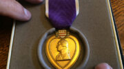 The Purple Heart stands as a symbol of sacrifice. Photo by: Nancy Carlson