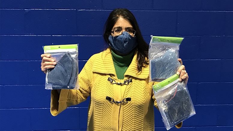 Ross Center's Executive Director Jacqueline Hanoman receives 620 masks from non-profit Classroom Connections of ECI. Photo by Stacy Wheeler
